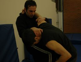 Knee strike to stomach whilst grappling