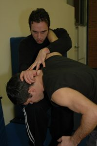 Knee strike to head from clinch