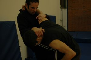 Knee strike to stomach whilst grappling (b)