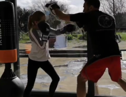 student coaching punching focus mitt pad